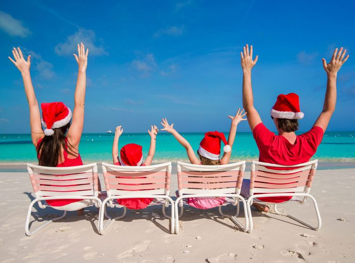 Family celebrating Christmas on beach