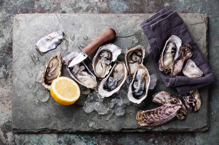 Oysters on cutting board