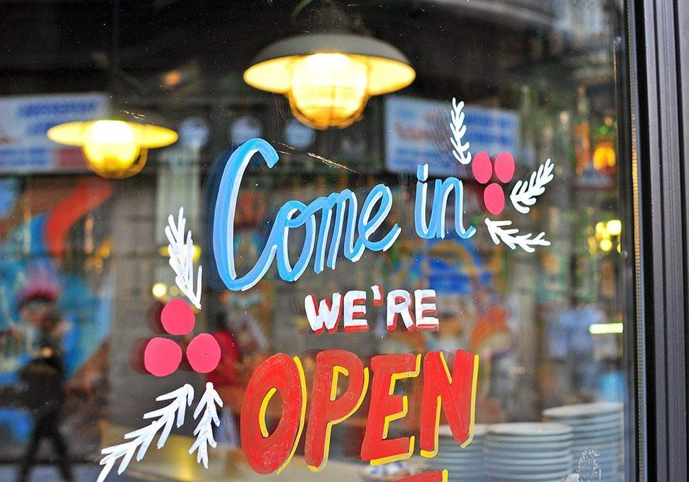 Open sign on window
