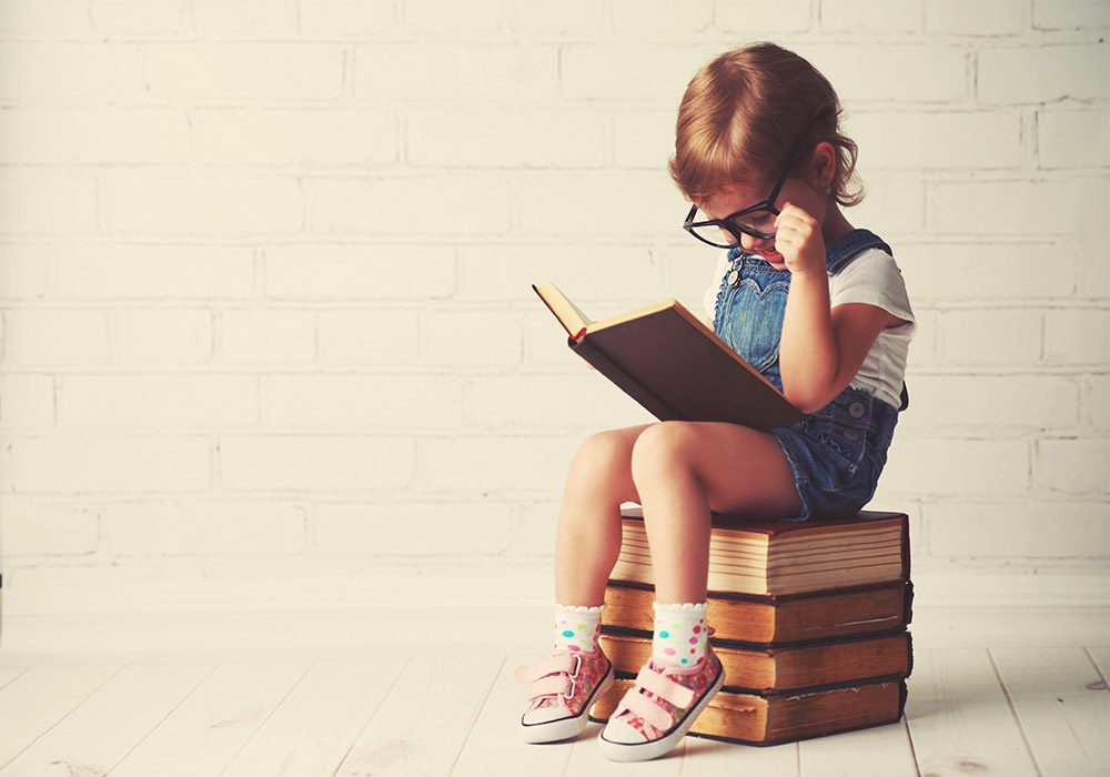 Little girl reading book