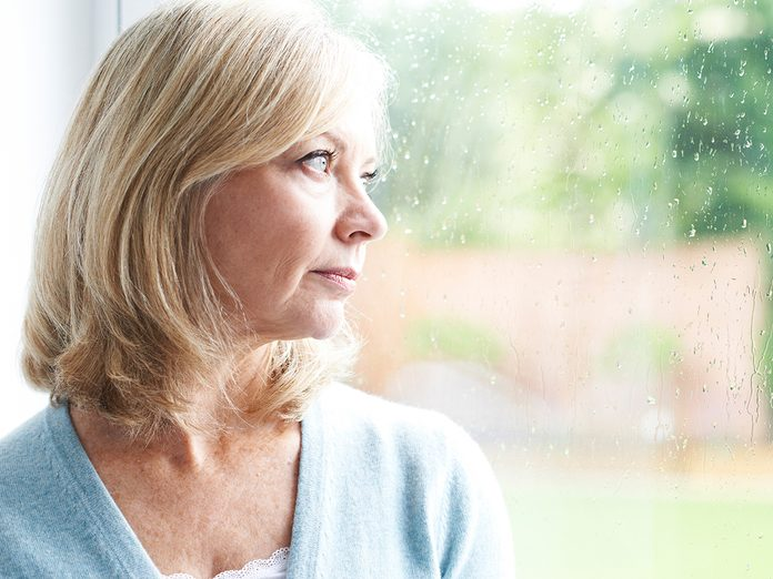 how to get rid of toxic friends - sad woman looking out window