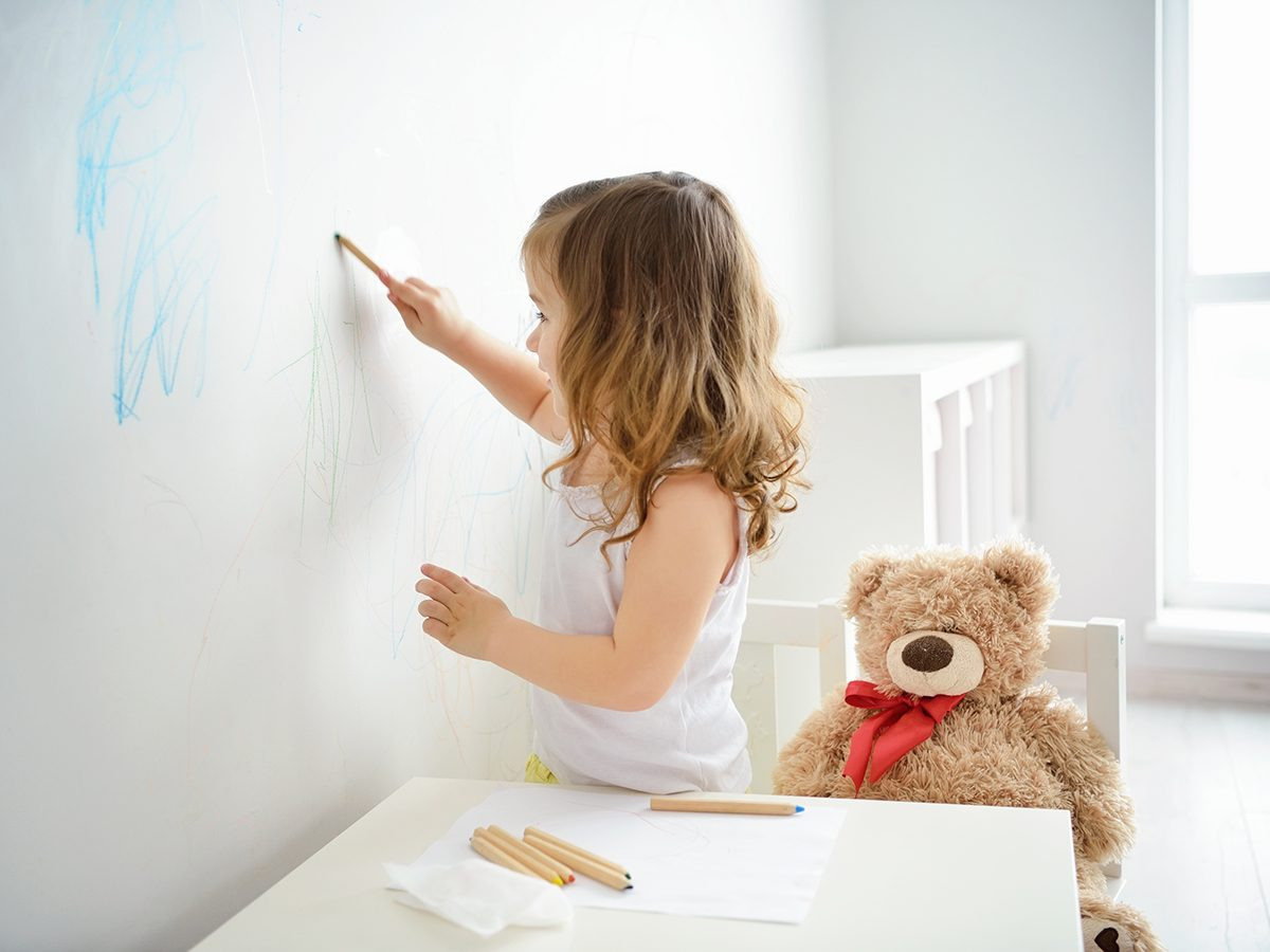 Things to do with toothpaste - little girl drawing on wall with crayons
