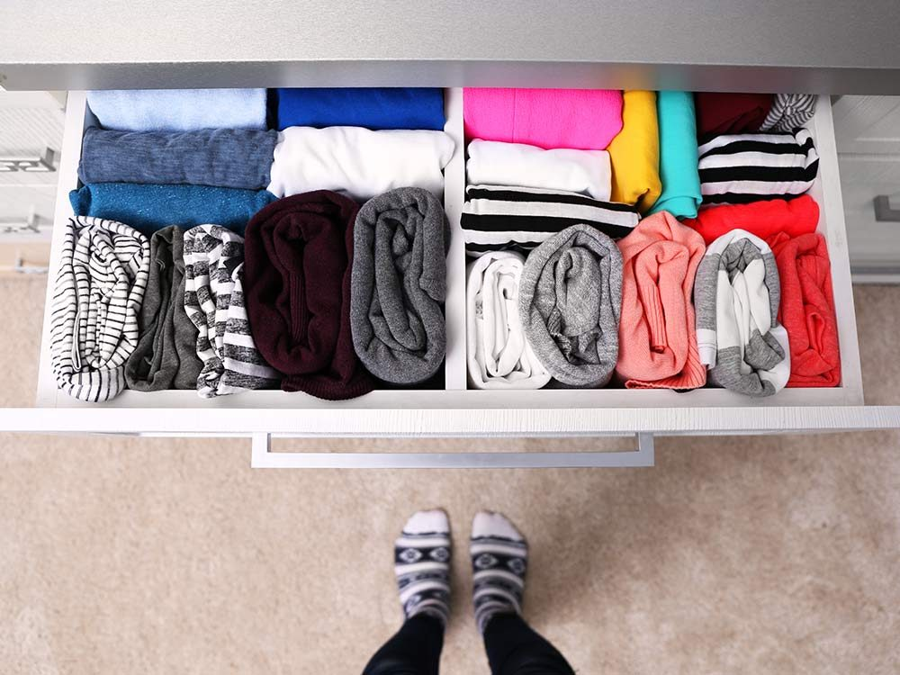 Clothes folded neatly in drawer