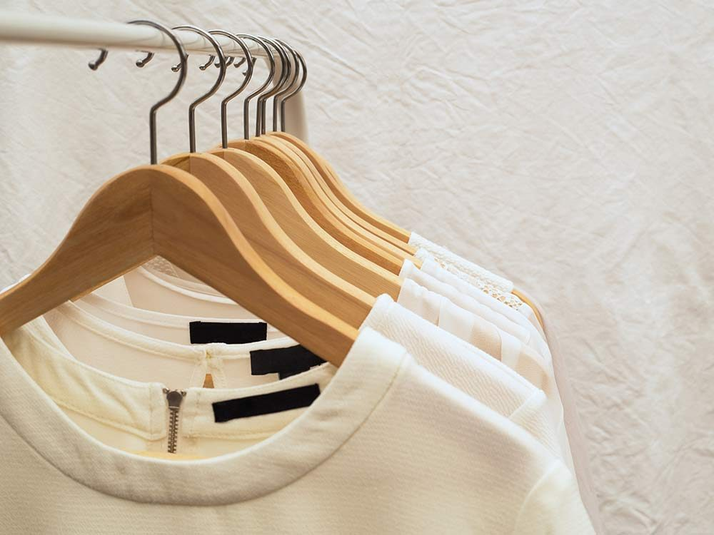 Blouses hanging on wooden hangers