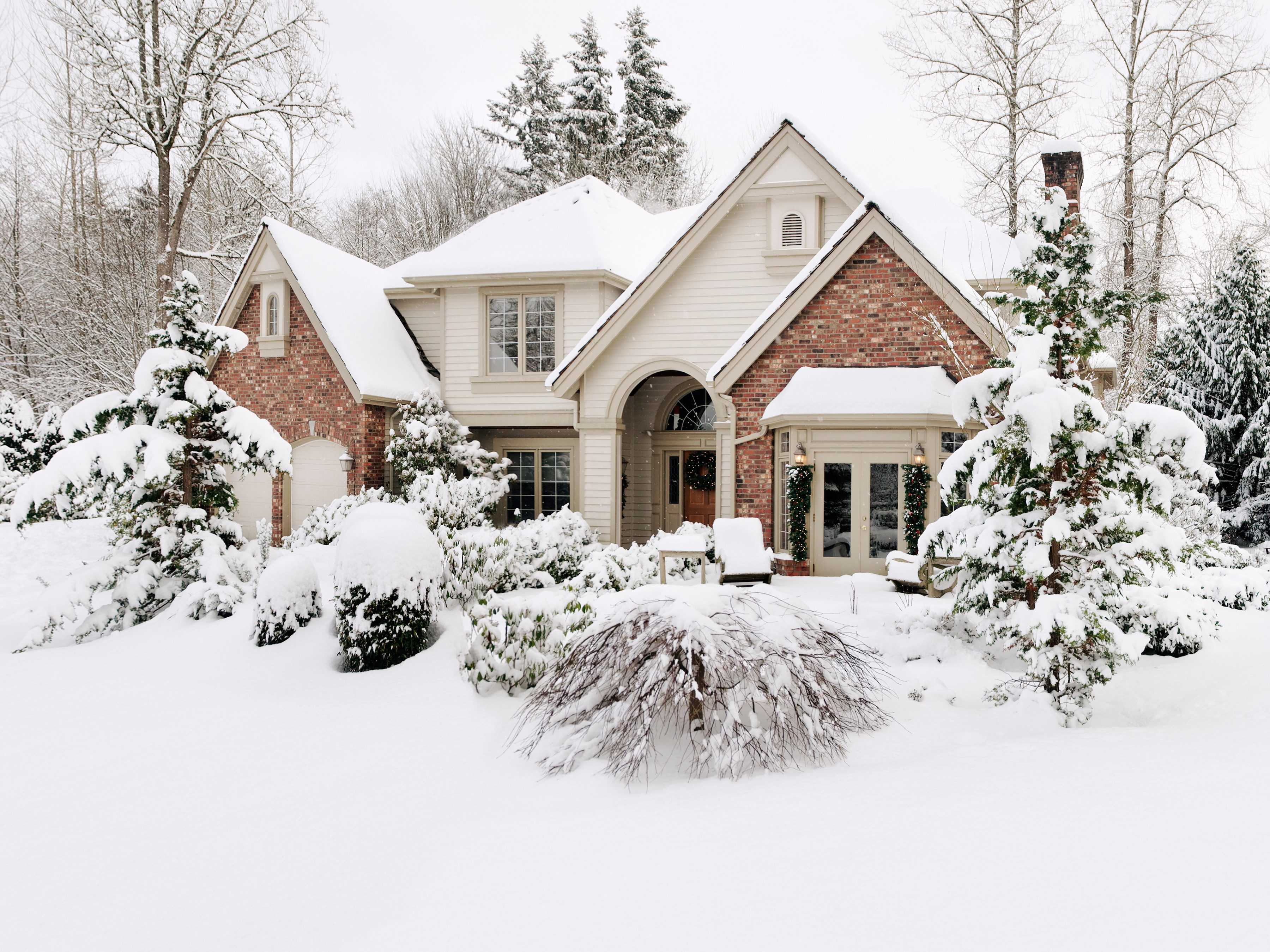1. Shovel snow away from your home's foundation.
