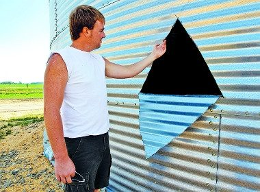 Arick Baker by the hole in the silo wall