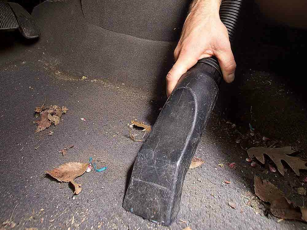 8. Slide seats forward and clean out the junk