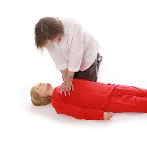 3. Make sure the person is on a firm, flat surface and kneel to his or her side.