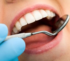 How often should people see a dentist?