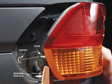 Pry Out Broken Taillight's Assembly (Captive Stud Method)