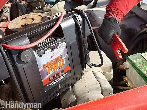 Jump-Starting A Dead Car Battery With A Booster Pack: Step