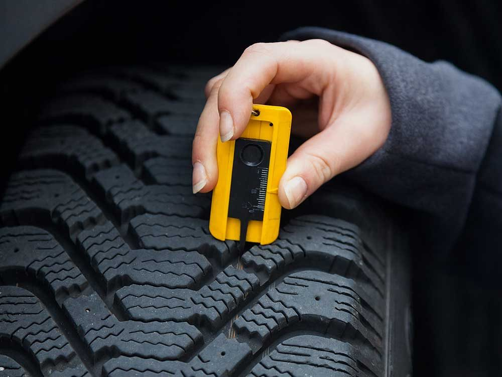 Use a tread-depth gauge every other month