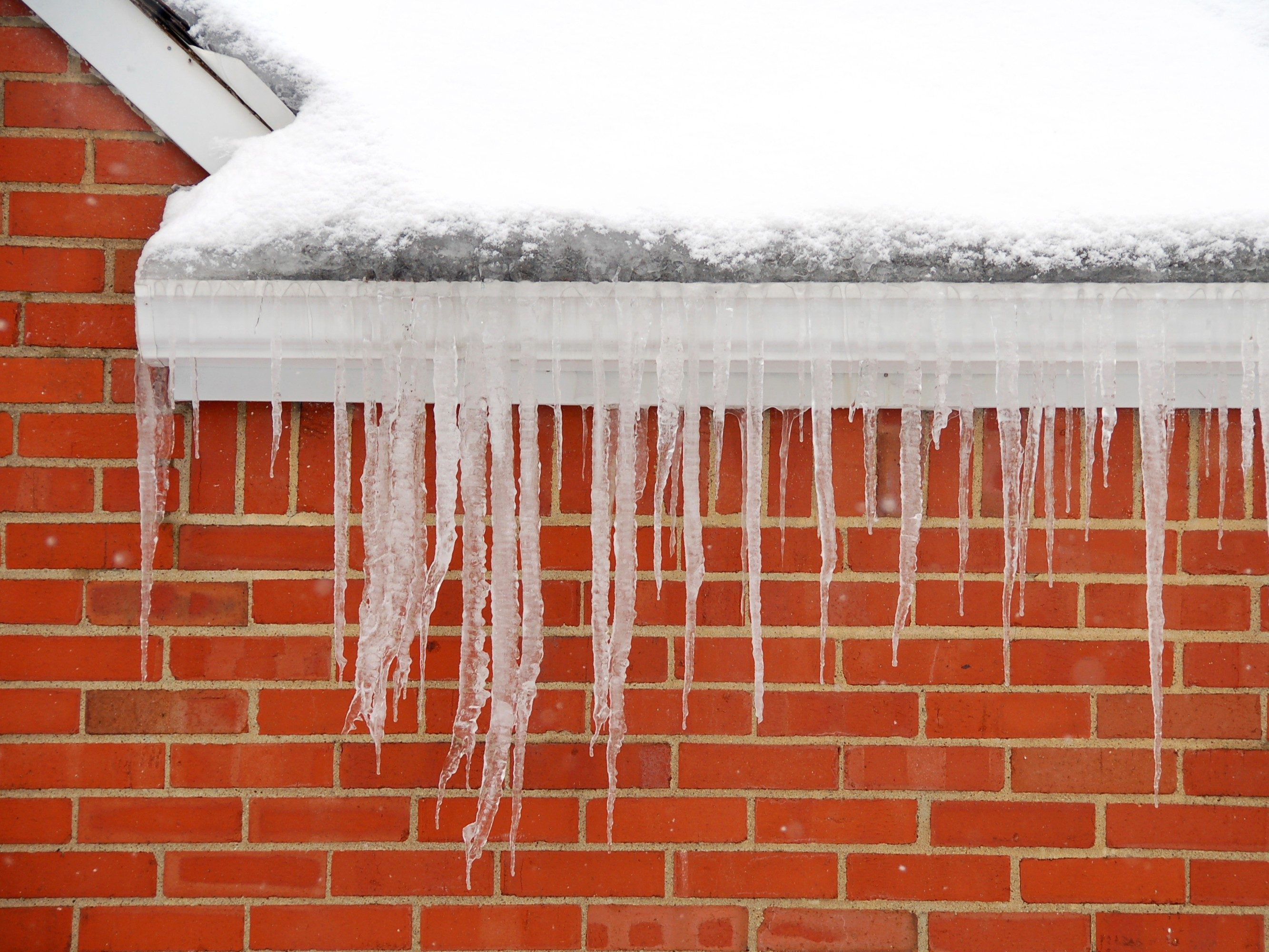 2. Remove ice dams on low-pitched roofs and gutters.