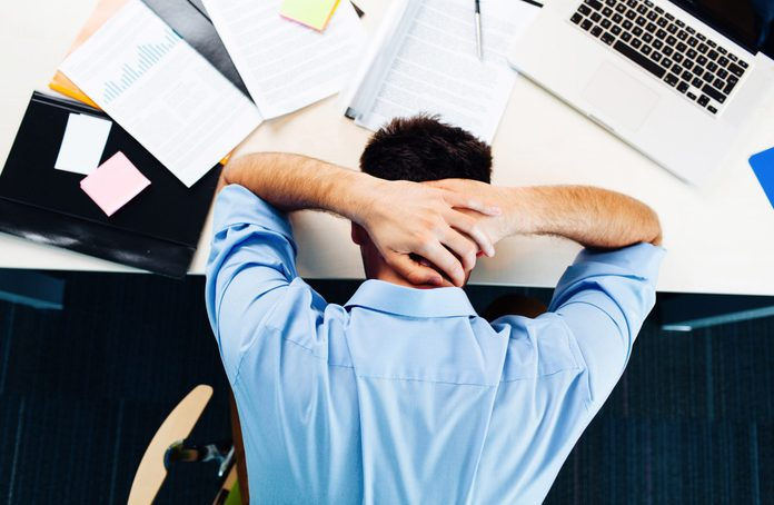Office worker with his head on his desk