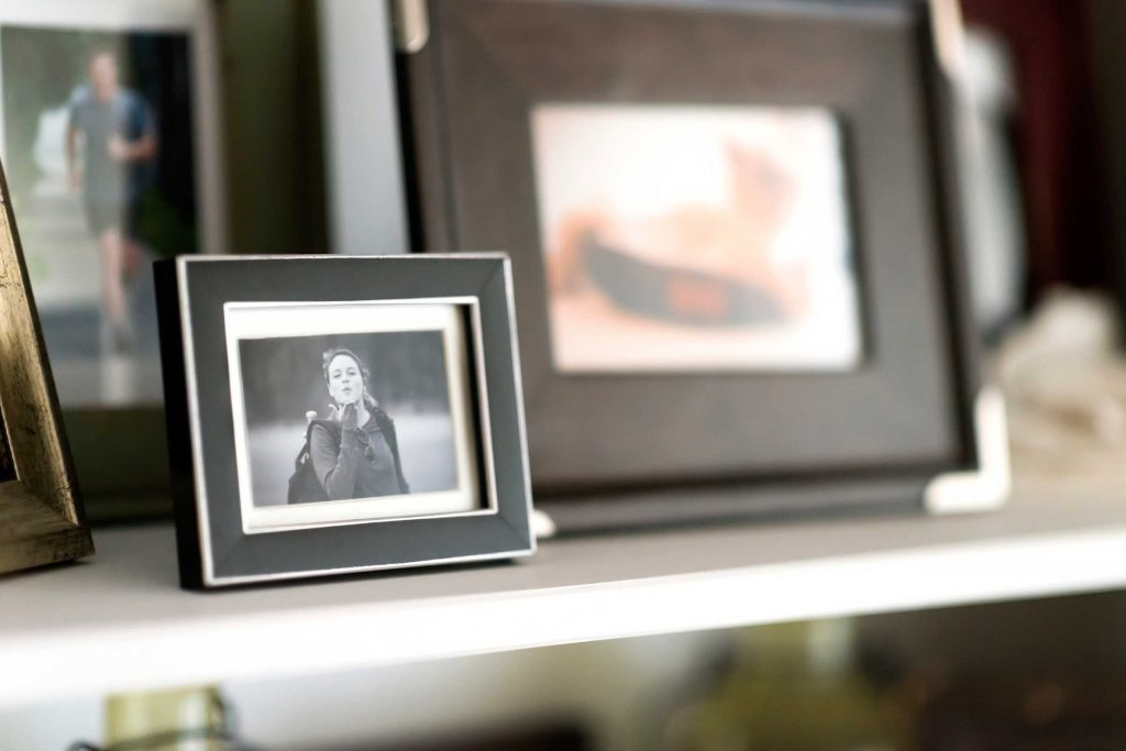 Picture frames displayed on shelf