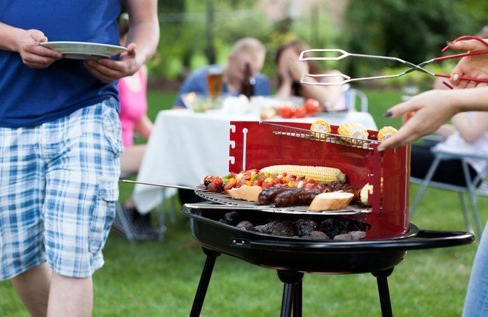 Friends having a backyard barbecue