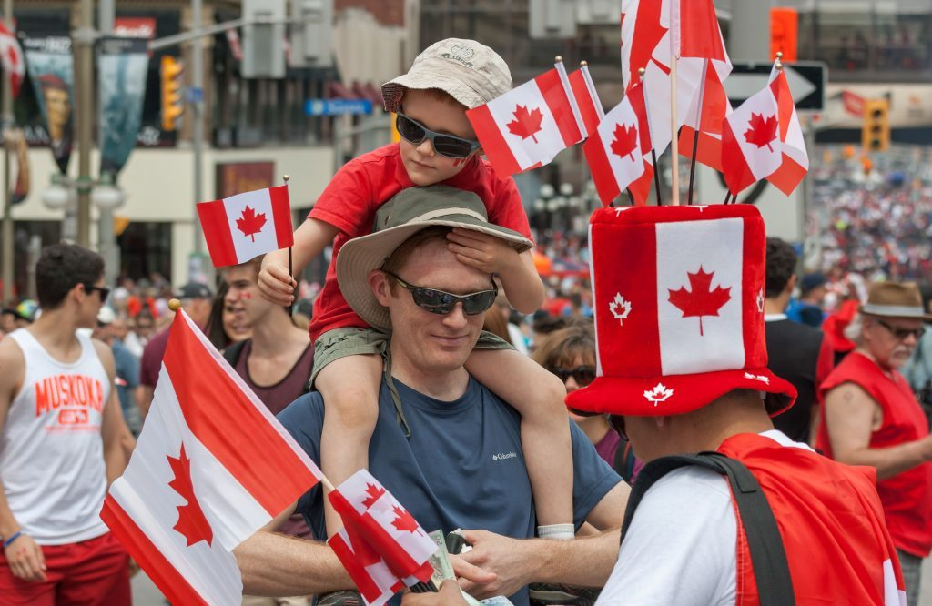 Father and son celebrating on Canada Day