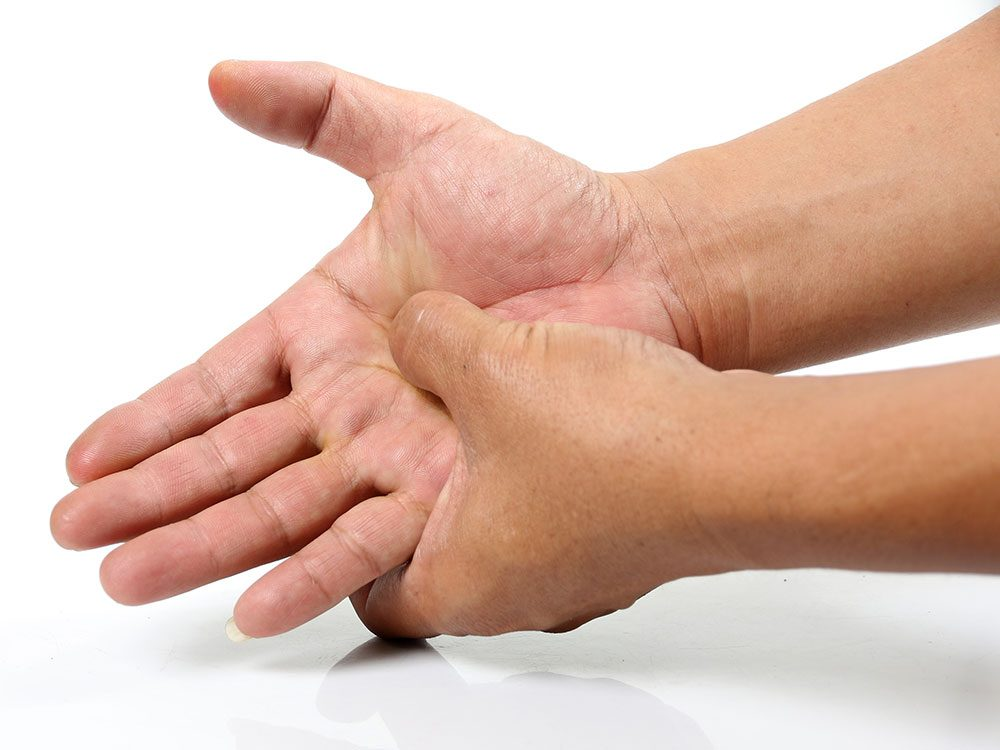 Get rid of hiccups by pressing the palm of your hand