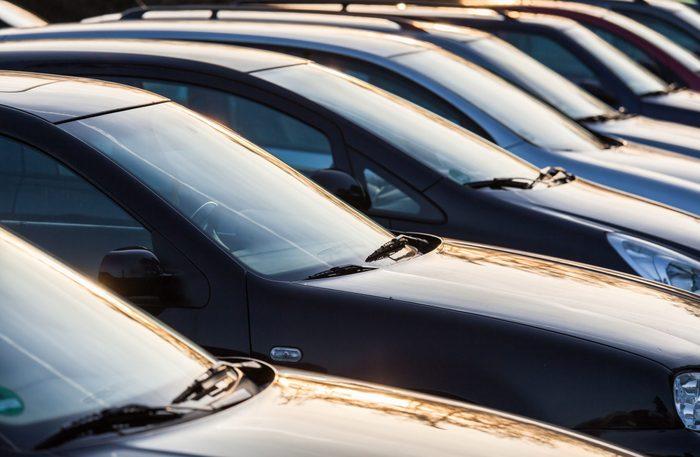 Row of dark coloured cars