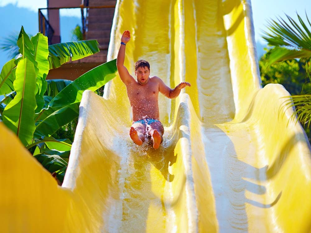 Man on water slide