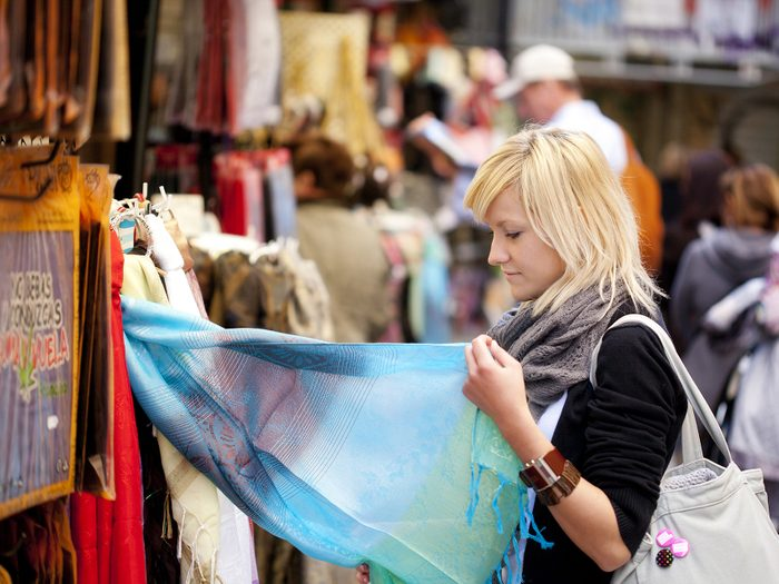 Woman shopping in market on vacation