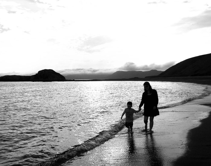 Mother and son walking at dusk