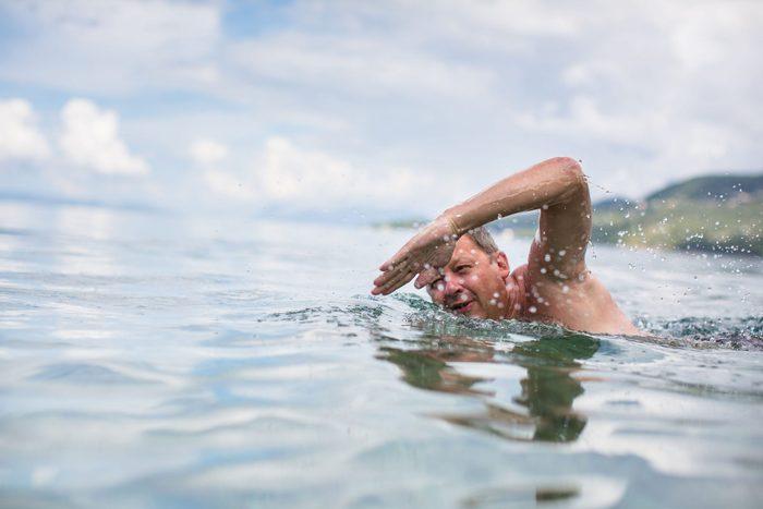 Mature man swimming in the ocean