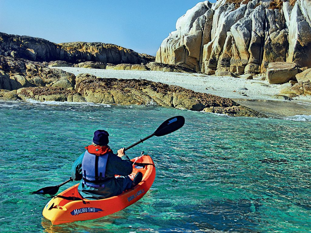 Kayaking along the shores of British Columbia's Calvert Island