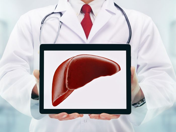 Doctor examining a healthy liver on an iPad.