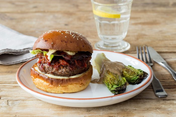 Juicy Lucy Burger with Tomato-Onion Jam and Charred Baby Gem Lettuce