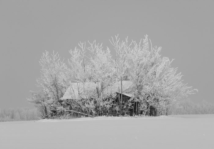 Snow covered farmhouse