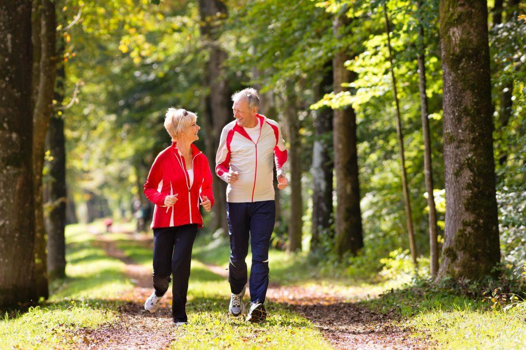 Elderly couple jogging in park