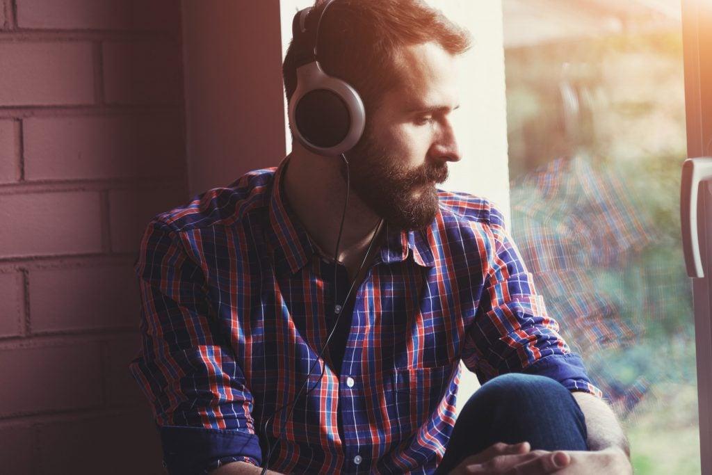 Bearded man listening to music