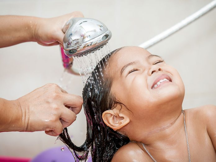 Mom washing little girl's hair