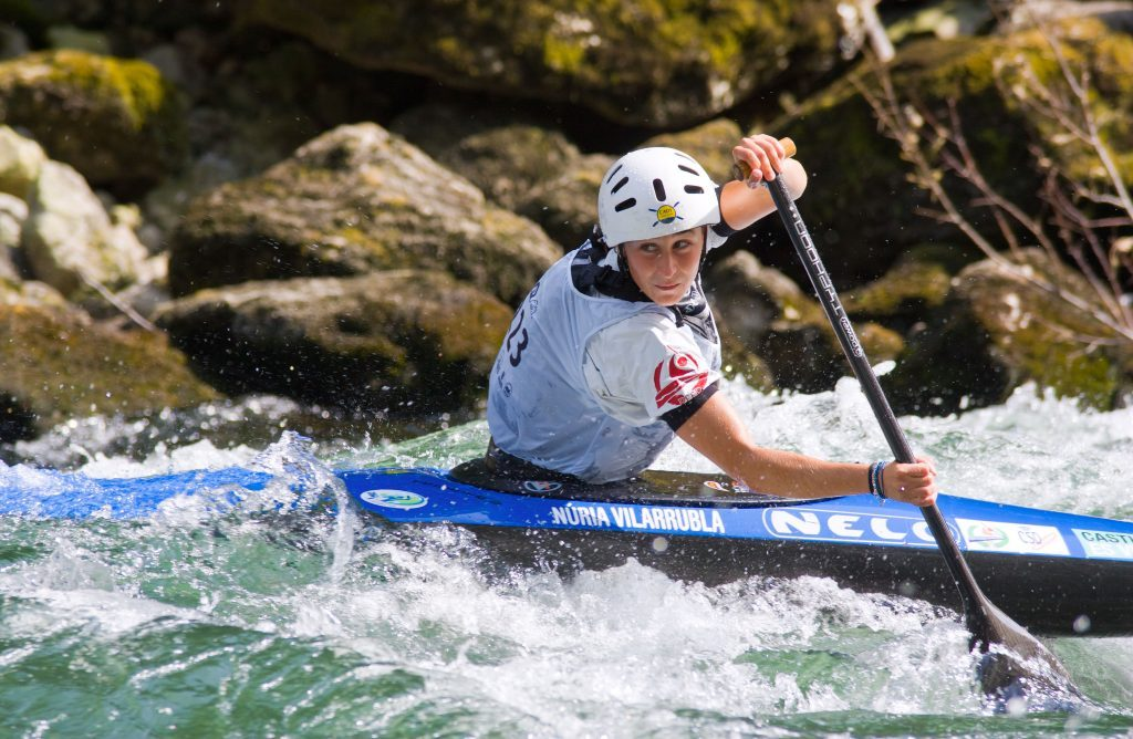 Canoe slalom racer in river