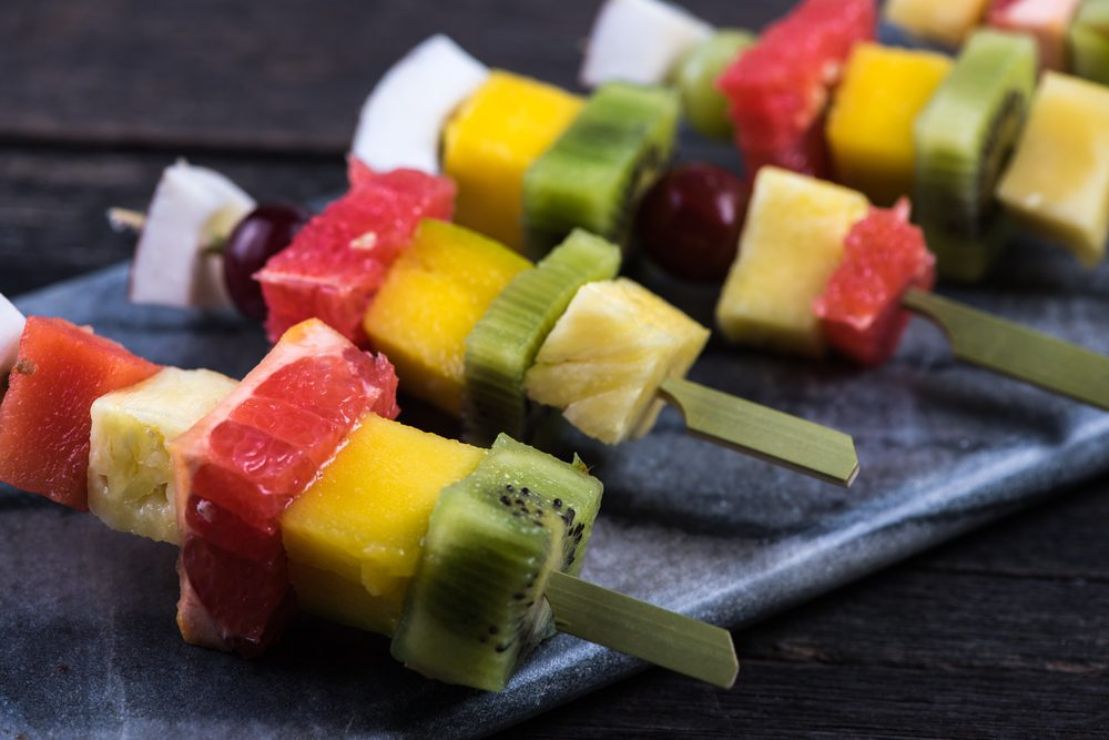 Fruit skewers on a grill