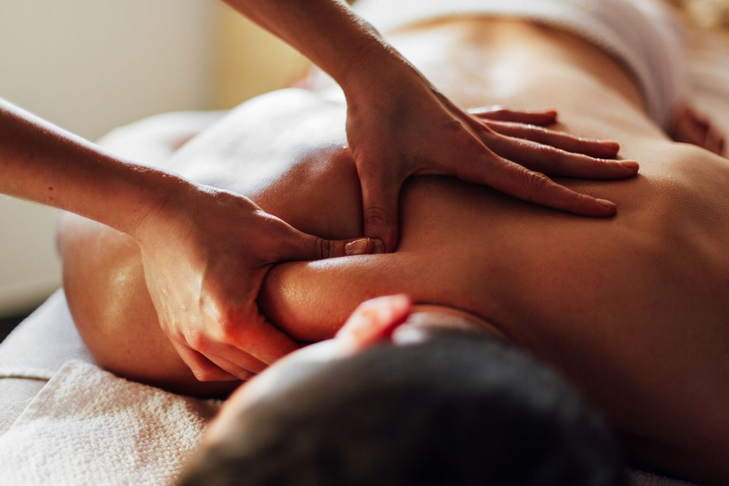 Man being massaged by chiropractor