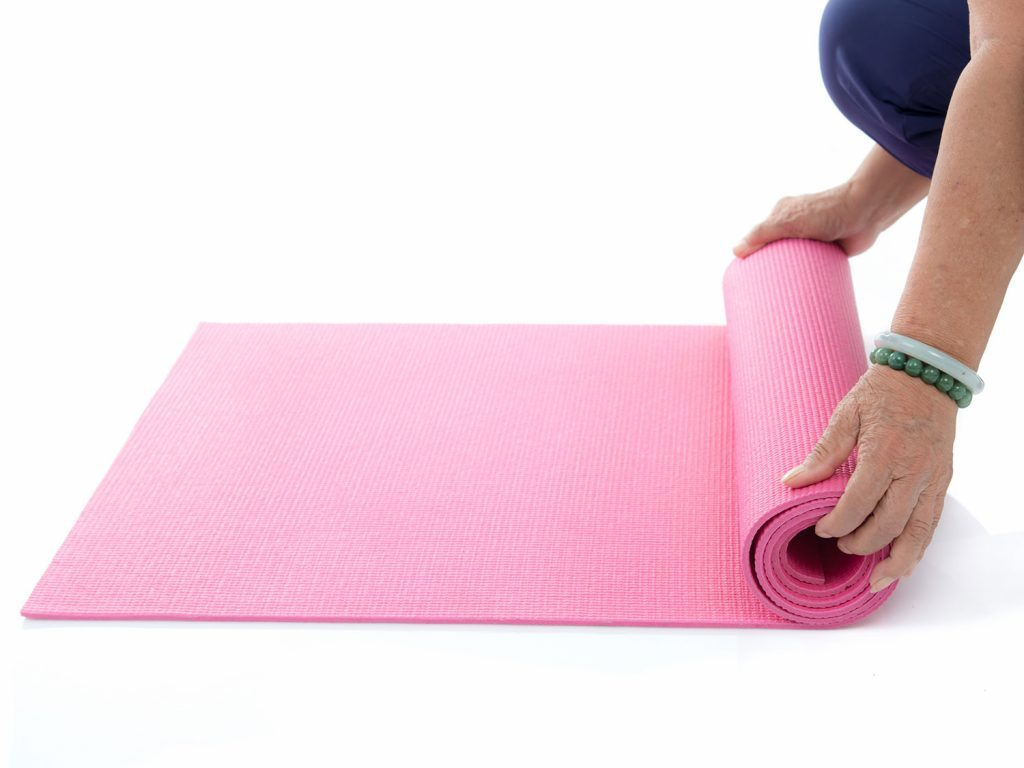 Rolling up a yoga mat for Pilates