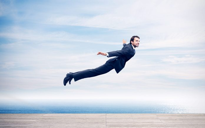 Man in a suit flying
