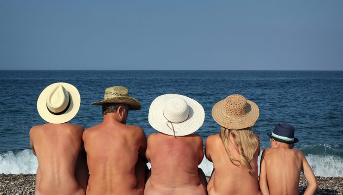 Naked family on the beach