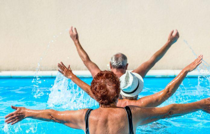 Seniors doing pool exercises
