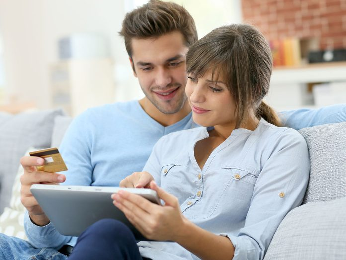 Couple shopping online on a tablet