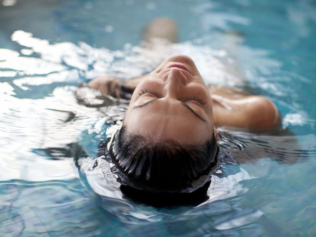 Woman engaging in hydrotherapy
