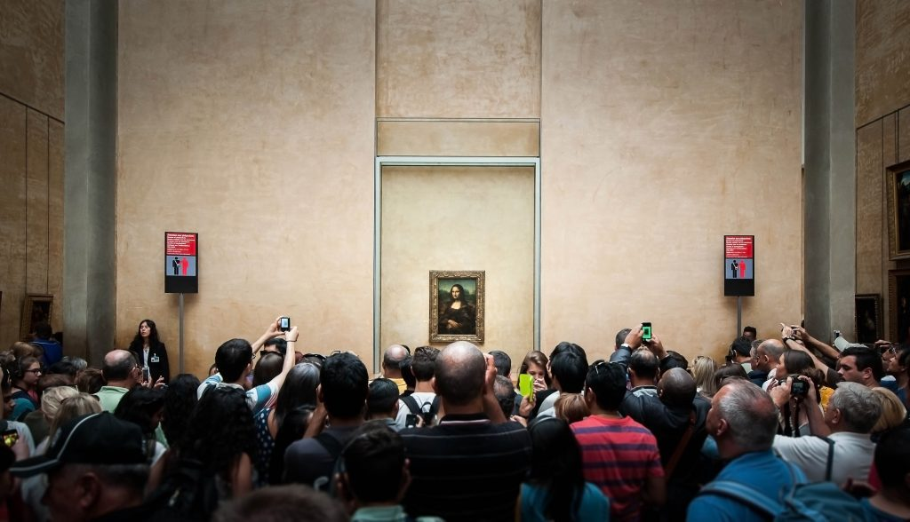 Crowd gathering around the Mona Lisa at the Louvre in France