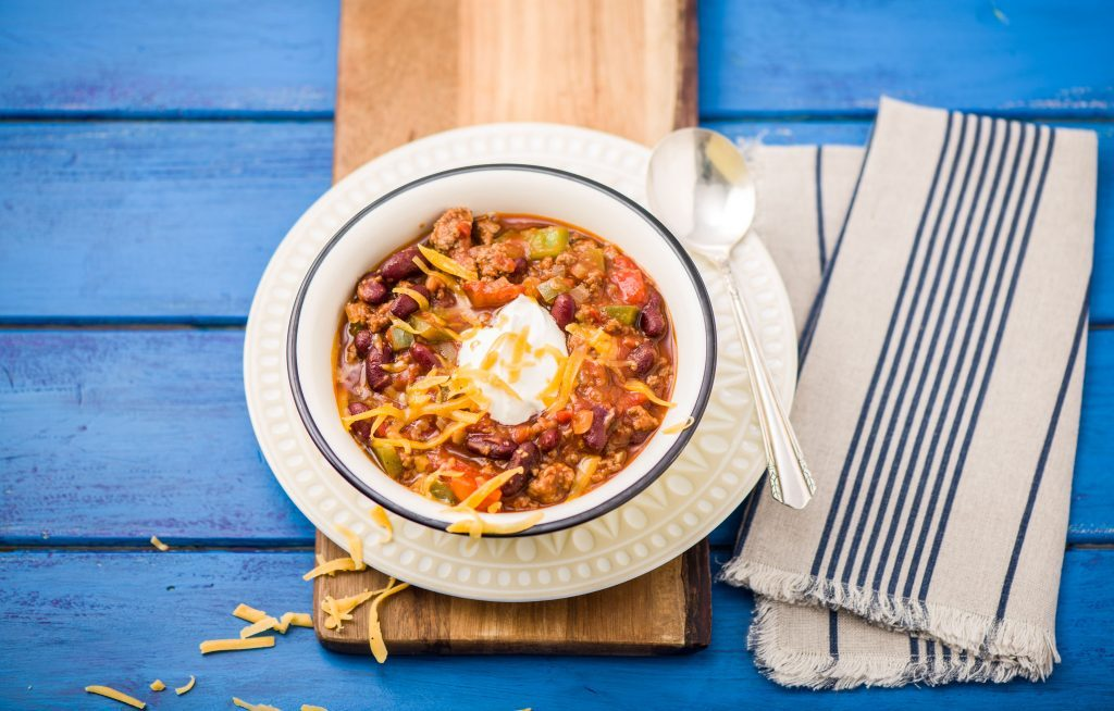 Beef chili with kidney beans, cheddar and sour cream