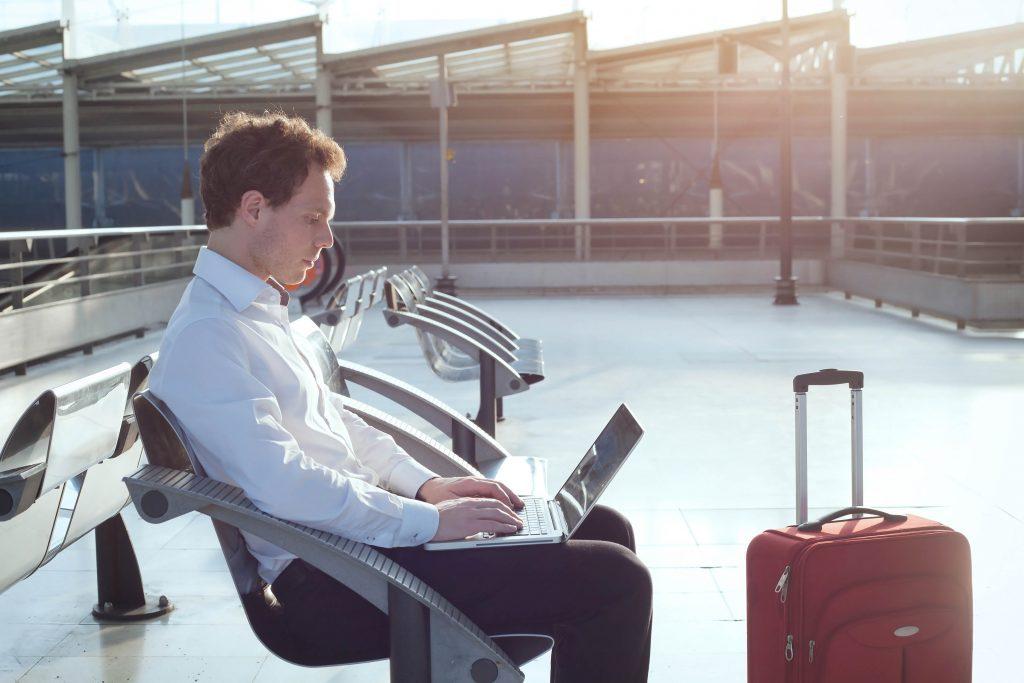 Man on laptop at airport