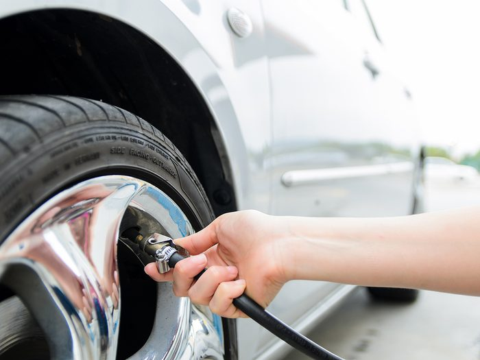 Car repair tips - Checking tire pressure. Pumping air into auto wheel. Vehicle safe concept.