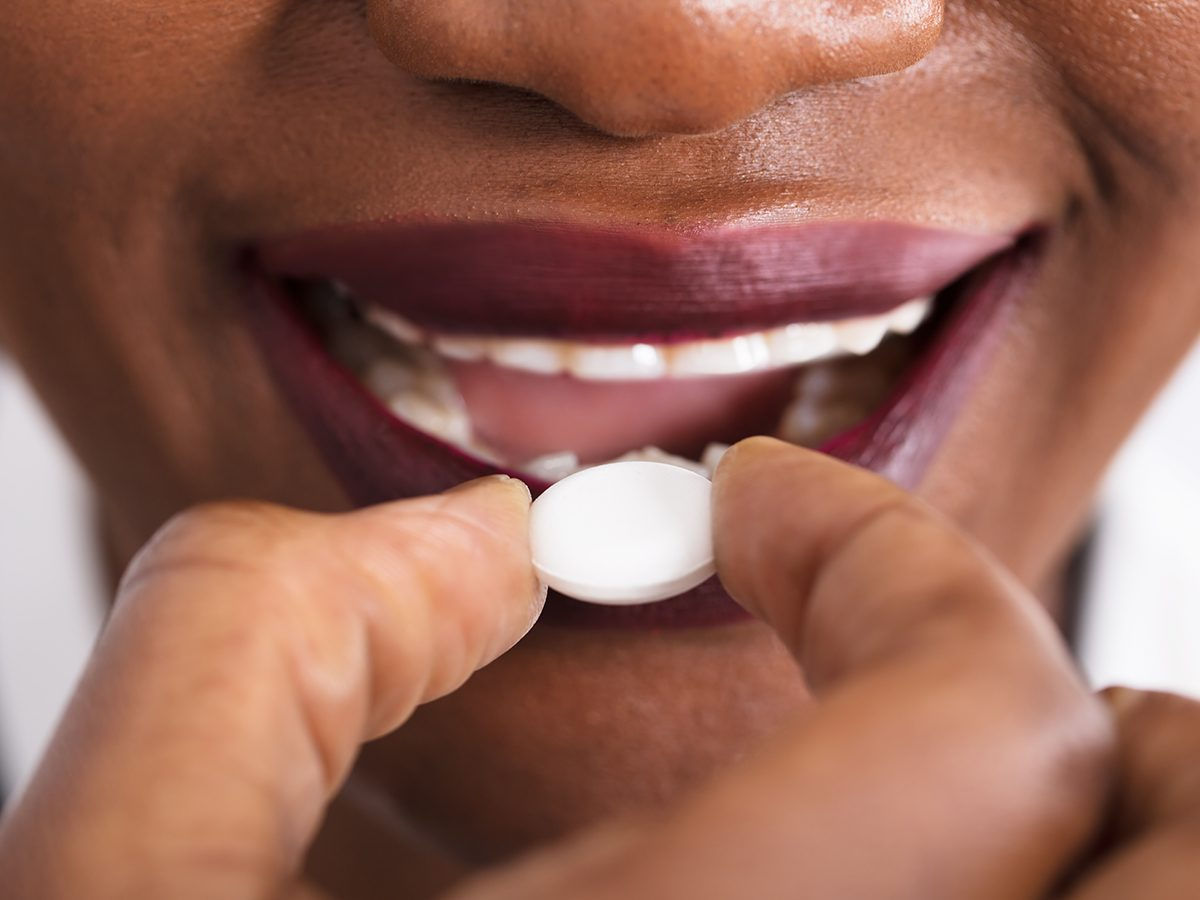How to improve gut health - woman taking pill