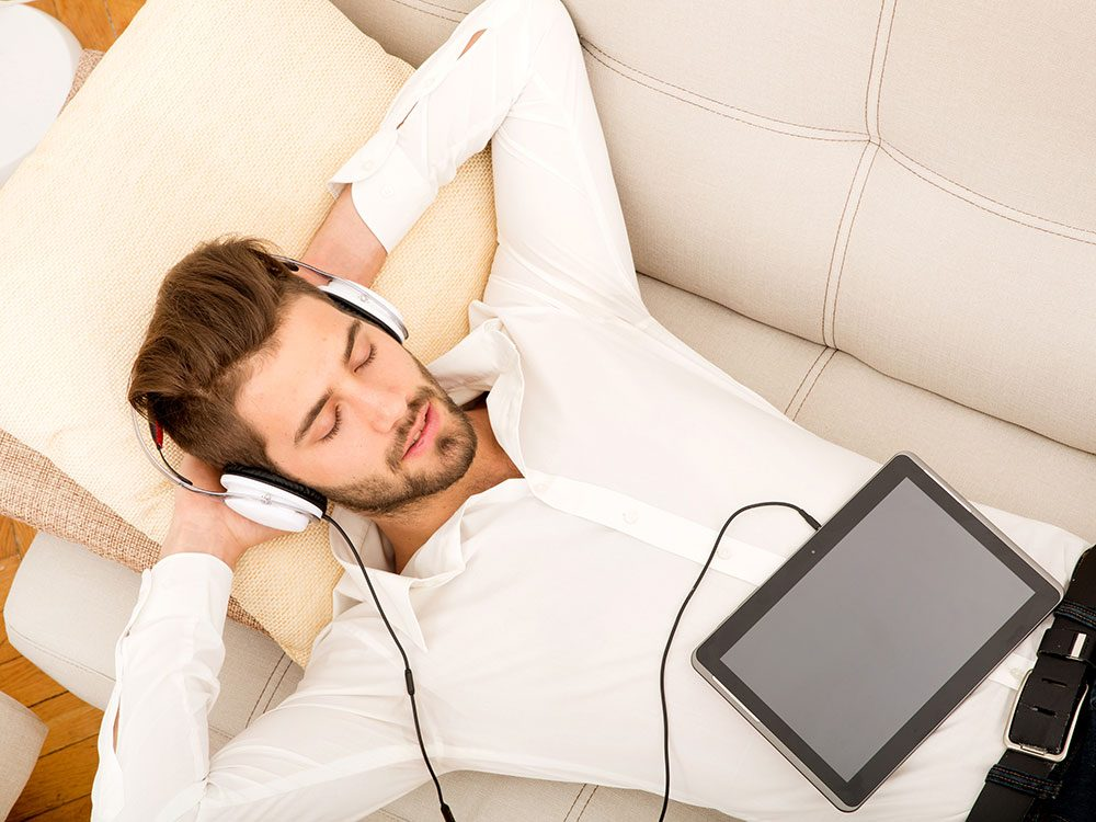 Man relaxing listening to music on headphones