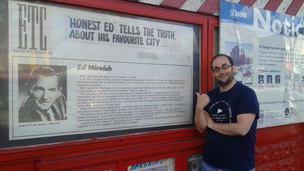 Adam posing in front of Honest Ed's during TIFF 2016